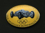 Enamel breast badge the 1935 Olympic Sponsors German motor race series. Flag marshalls issue in yellow.