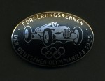 Enamel breast badge the 1935 Olympic Sponsors German motor race series. Mechanics and team crew issue in black.