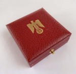 Presentation case for the large Golden Party Badge.