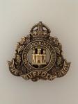 Suffolk Regiment metal cap badge. Brass WW1 economy issue ANTIQUED.