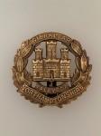 Northamptonshire Regiment metal cap badge. Brass WW1 economy issue ANTIQUED