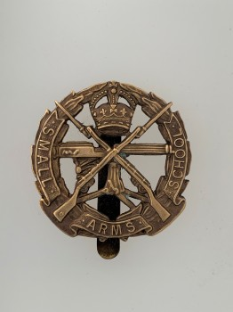 British Army Small Arms School Corps metal cap or beret badge ANTIQUED.